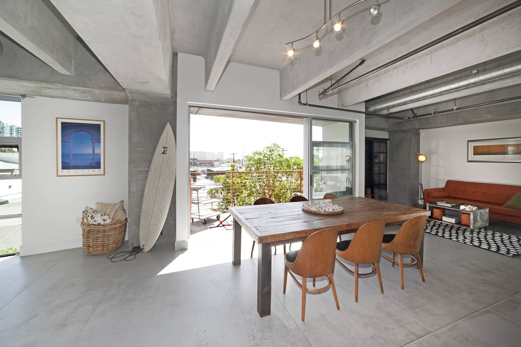 Ever since the 70's when developers began converting factories to spacious urban homes, the deep appeal of loft living has not subsided. In this case, though, it's not a conversion. This is all by design. With polished concrete floors, and 10' concrete ceilings with exposed services, the space has an unmistakable industrial character.