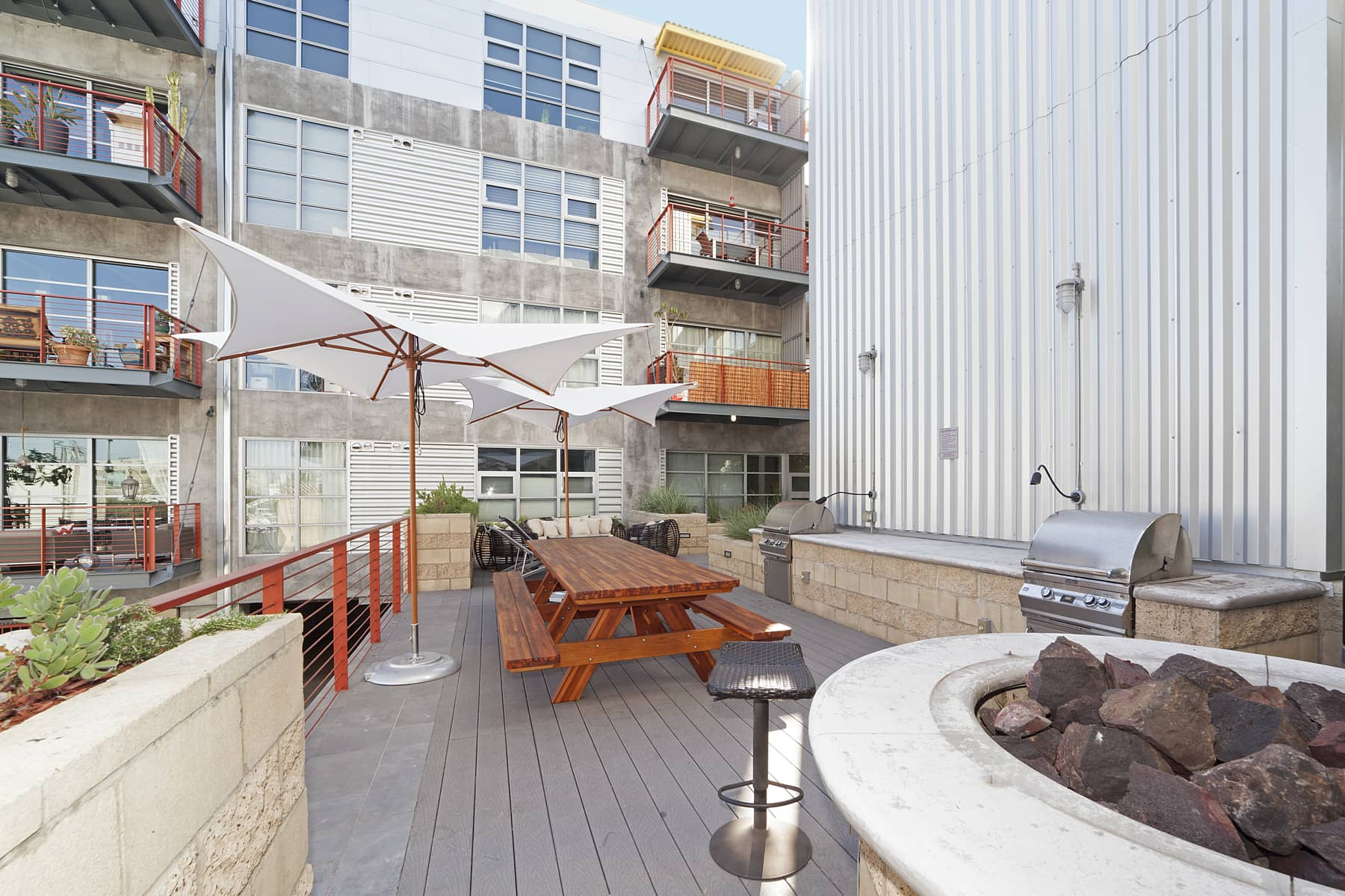 The complex features include a fitness center, gated parking garage, a large bicycle storage room, and an outdoor courtyard with gas grills, fire pit and comfortable furniture for lounging with friends.