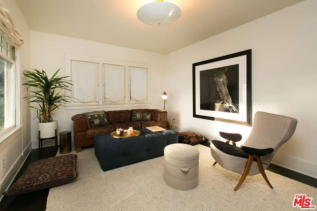 Beginning with this cozy living room, the house features 3 bedrooms, 2 bathrooms and 1364 square feet of living space.