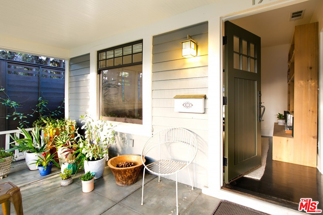 Originally built in 1916, there is a lot of attention to detail throughout this beautifully redesigned and updated California Bungalow. Even the front porch has tasteful touches all around which make you want to linger for more than a moment before going inside.