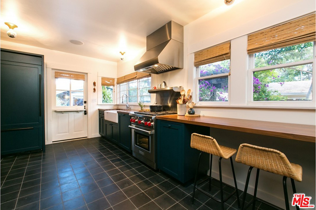 The home also features a completely updated kitchen with high-end appliances, a farmhouse sink, and, always on my kitchen wish list, plenty of natural light.
