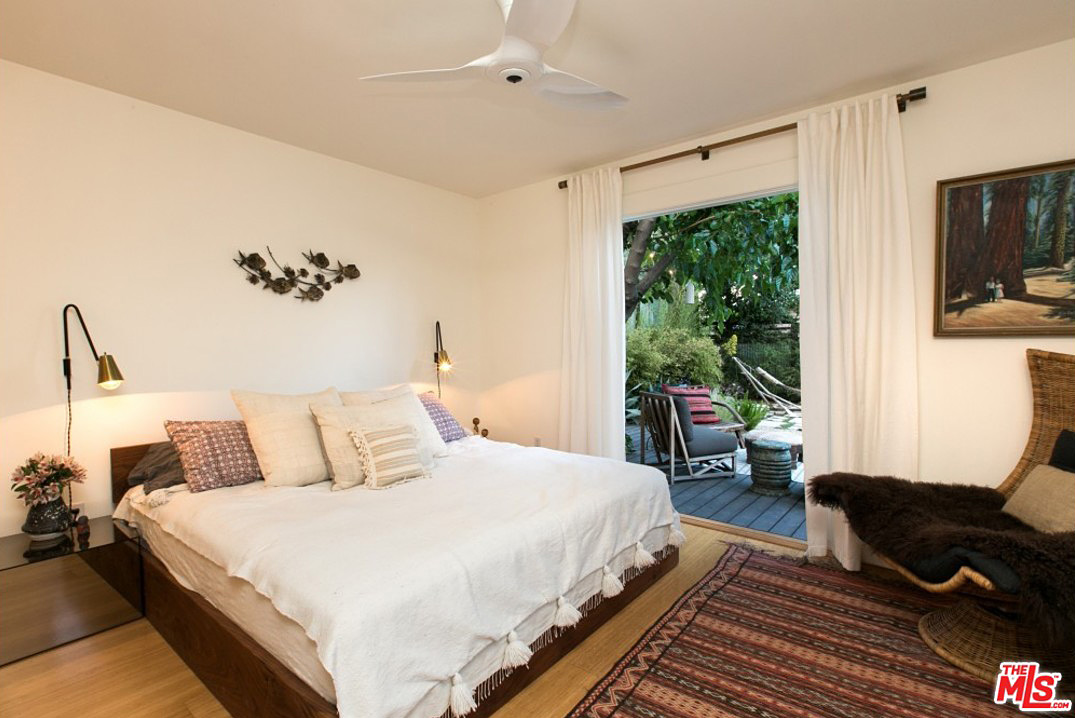 Beautiful hardwood floors warm up this bedroom, but the eye can't help but be drawn to the deck and private oasis that lie just outside that door.