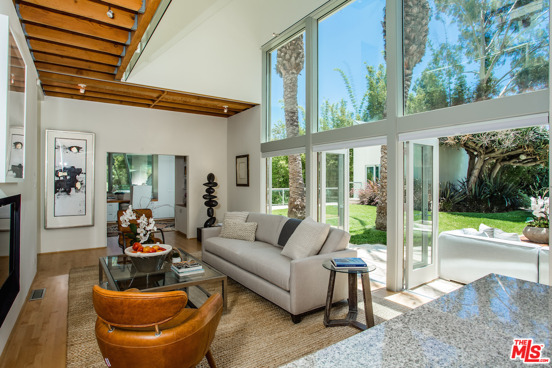 The home features 5 bedrooms and 5 baths in 4,736 sf of living space. Other rooms include a great room, dining room, den, art studio, office, guest house, gym, home theater, and library/study.