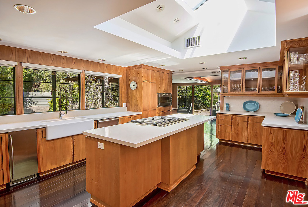 Originally built in 1936, the home endured modifications and additions before being lovingly restored to its current condition. There has also been some updating, of course. But they've been done in a manner that adheres brilliantly with the home's original aesthetic – such as this kitchen.