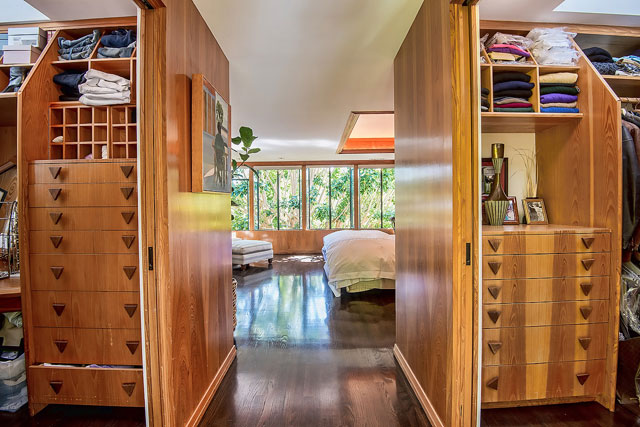 Stunning woodwork and built-ins are found throughout the home, such as this walk-in closet in the master bedroom.