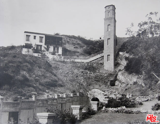 Here's a cool photo showing this this home and the tower - the only two structures occupying the hillside. This home actually predates the tower.