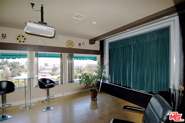 Here, in the living room, the home currently features a little a theater. But the real show is out the windows. Nearly every room in the house enjoys spectacular views.