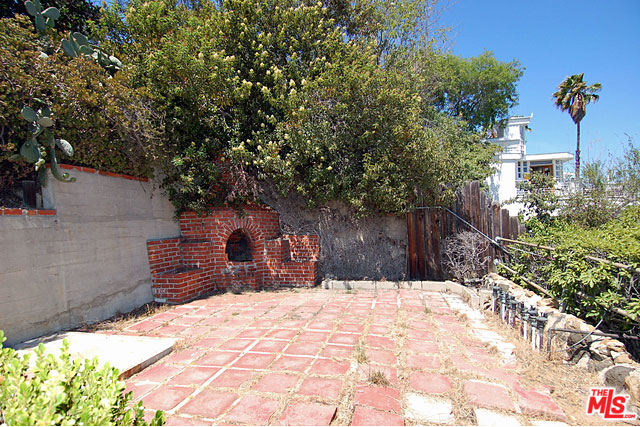 Outside, a nice level area features a spacious brick patio and a built-in brick barbecue.