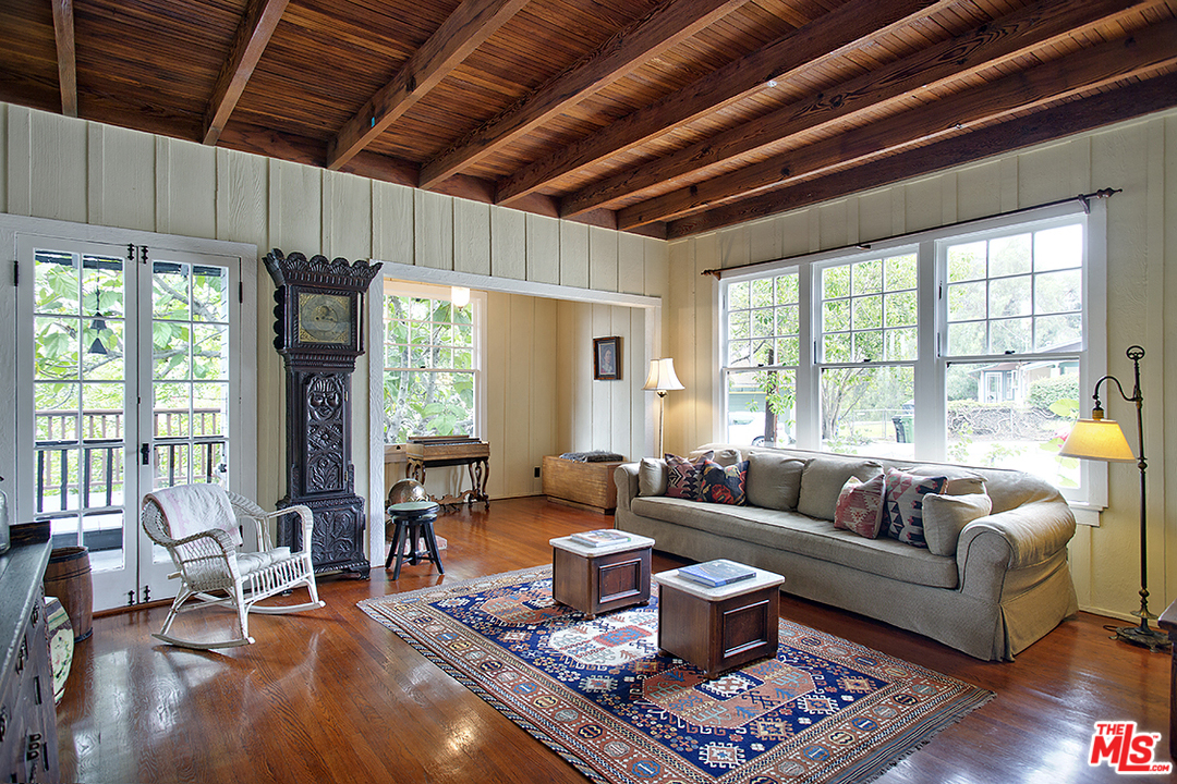 Built in 1907, this home still enjoys most of its original features including rich woodwork and hardwood floors, board and batten walls, open rafters with tongue-in-groove ceilings, and wraparound decks to take in the views.