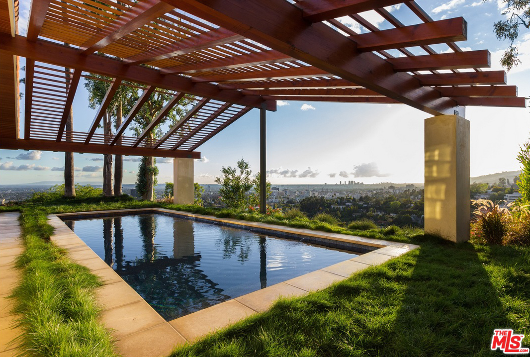 With a dark bottom and framed by lush grass, the salt water pool has the ambience of a mountaintop lake, which makes it somehow feel private even while offering180-degree views of forever.