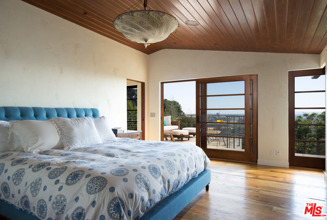 The master bedroom opens to a patio, the perfect setting for a lazy Sunday morning breakfast, or a nightcap while looking at the stars.