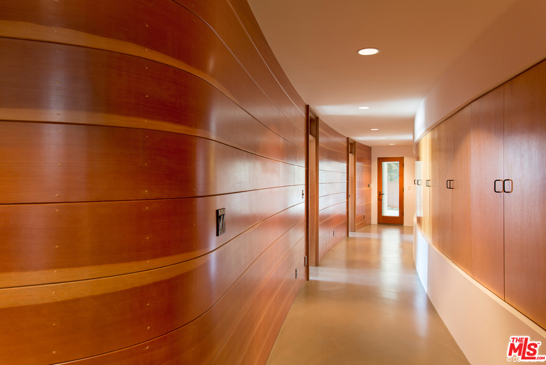 You can get a sense of the home's curving design by looking down the hallway.