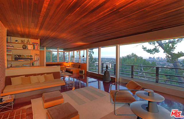 With ceilings lined with rich, tongue-in-groove planks of wood, the living room has a casual, even cozy, warmth to it. Combined with Neutra's ever-present built-in seating, and the breathtaking views beyond the wall of glass, this is a room in which you'll want to settle in for the long haul.