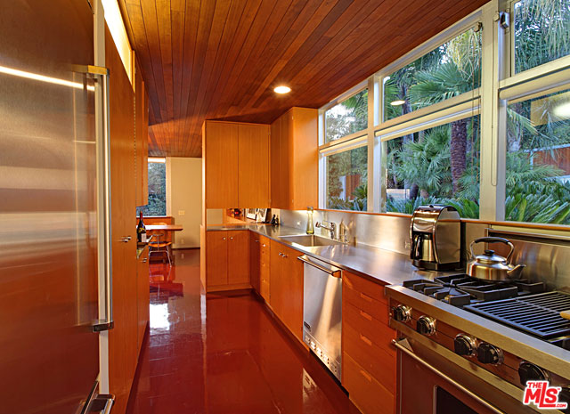 The home features a galley kitchen updated with modern amenities, but still remains true to Neutra's original vision.
