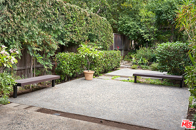 Situated on the 7,024 square foot lot, the home enjoys a private yard surrounded by mature trees.