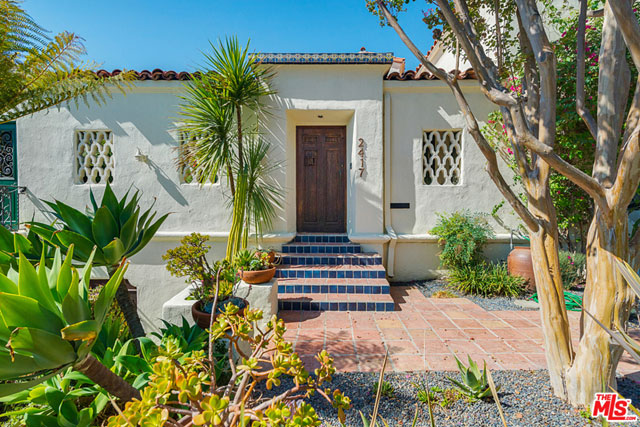 Built in 1927 by John William Chard, this stunning 4 BR / 3.5 BA home makes a very big impression right out of the gate. The deeply recessed door shown here, which is flanked by ornate concrete window grills, is not the front door to the house. It's an exterior wall that opens to…