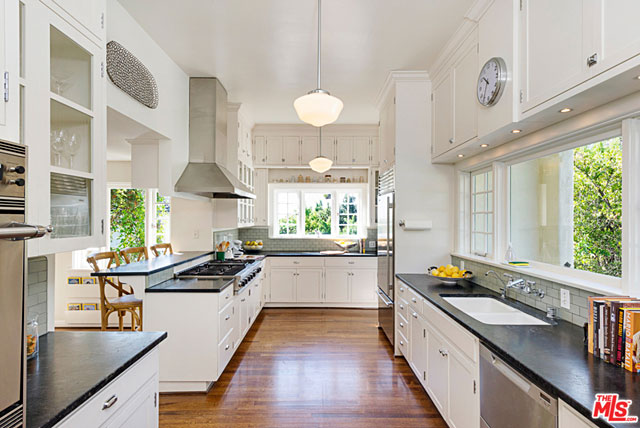 Bright, airy, spacious, ample counter space and top-notch appliances. This is a true chef's kitchen.