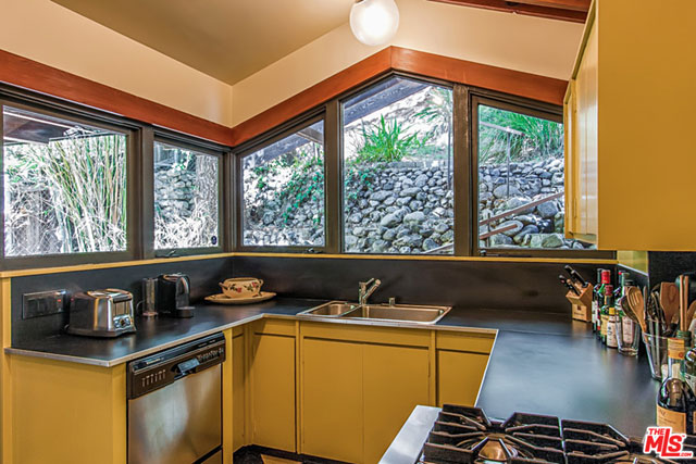 Although it features modern amenities, the kitchen retains a pleasant vintage vibe. And the geometry of its windows is fantastic.