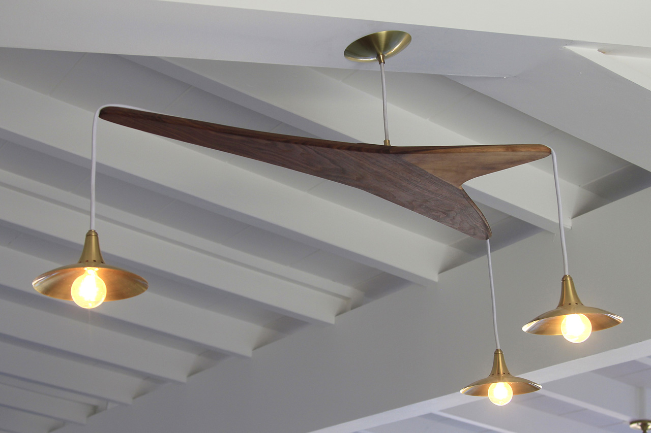 This one features brass and wood, which matches the wood of the bar and cabinets.
