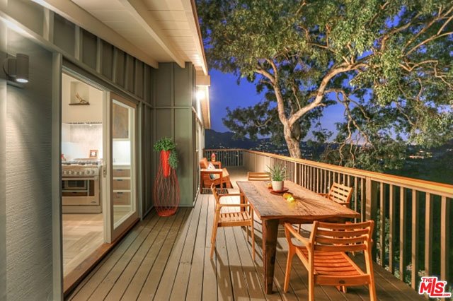 Every room in the house opens up to the outside, including the kitchen. This portion of the deck, which benefits from the cover of matures trees and a steady breeze is the perfect spot to enjoy a romantic dinner.