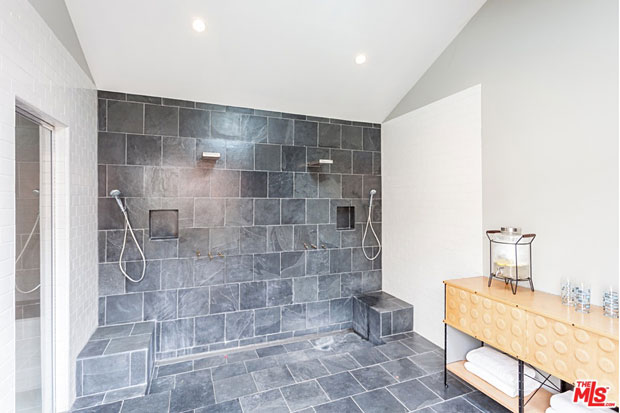The main room within this outbuilding is an enormous shower room, featuring two side-by-side showers.