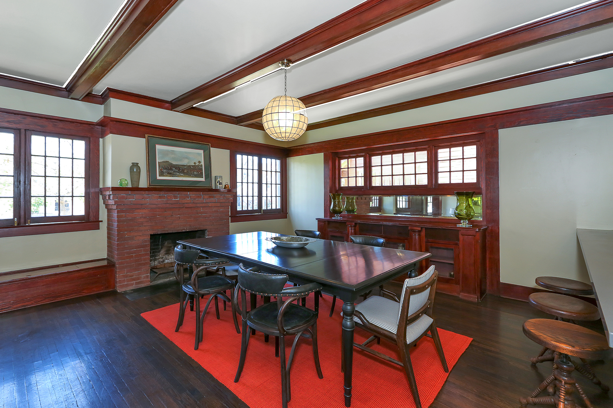 Another uncommon design element, which I love, is the placement of the fireplace in the dining room. And, of course, the beauty of the original built-in hutch must not be overlooked.