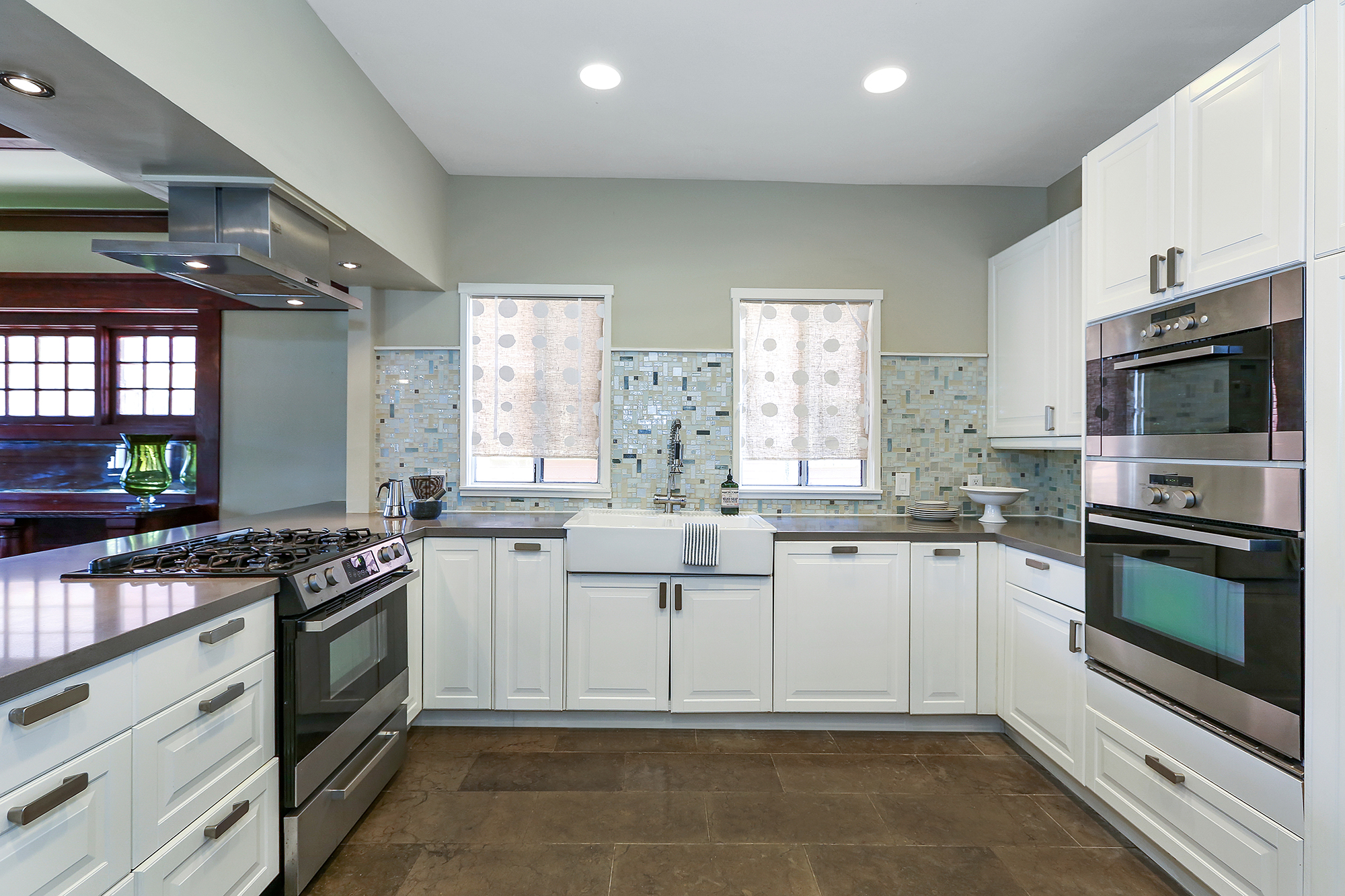 The kitchen, which features stainless appliances and Anne Sacks tiles, is large enough for folks to congregate in as dinner is being prepared.