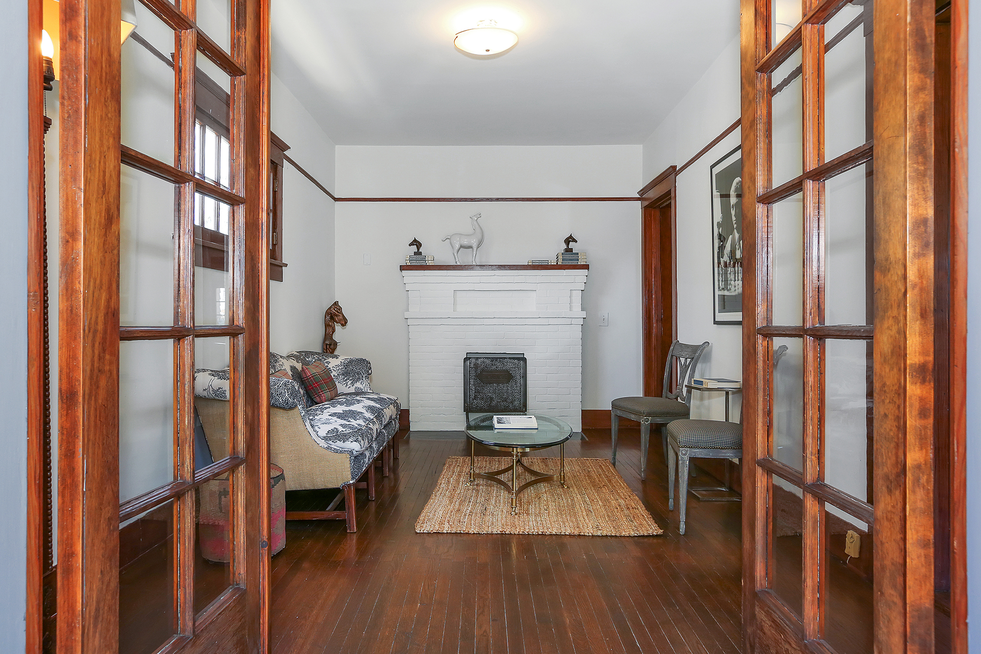If you need an extra room for an office, studio, gym, or just a private man-cave, this home has it. In fact, it has two! Pictured above is a private library/studio, with French doors that lead out to the back porch. And below…