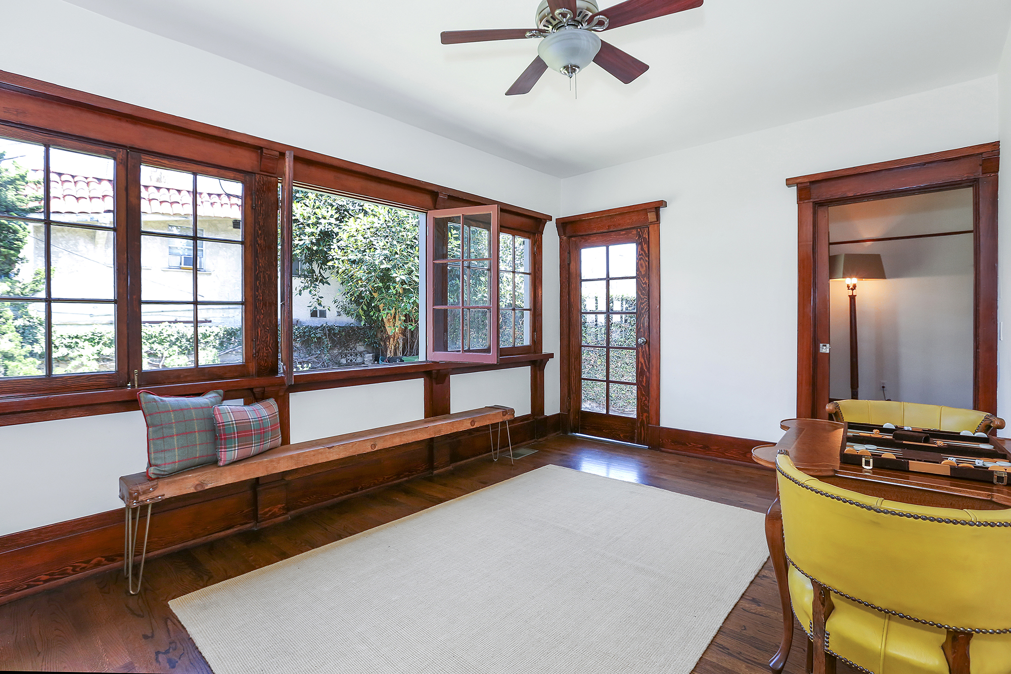 We have a wonderful sunroom, featuring a wall of windows whose eastern exposure allows the morning light to spill inside the room.