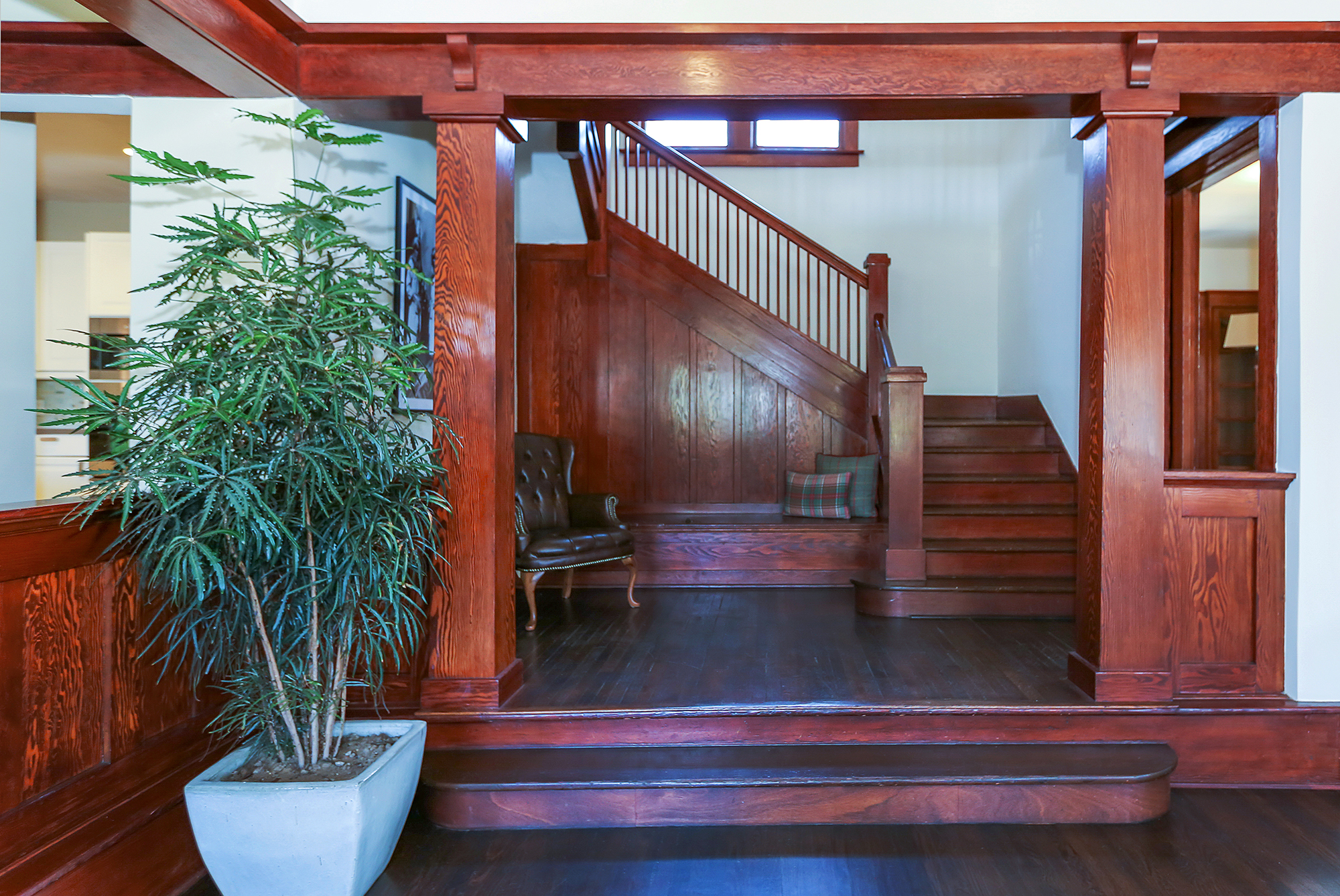 The wrap-around staircase is literally and figuratively a centerpiece of the home. It features landing at the bottom that can easily accommodate a piano, and another landing at the top, which is large enough to be its own gathering area.