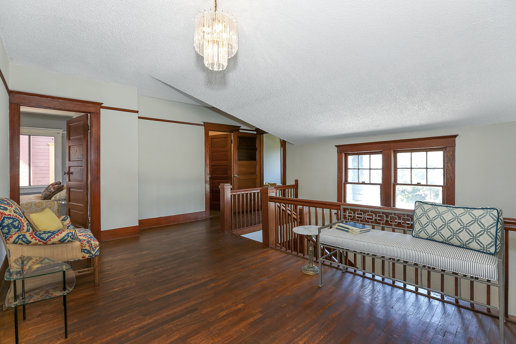 The upstairs landing is surrounded by five bedrooms and a common bathroom.