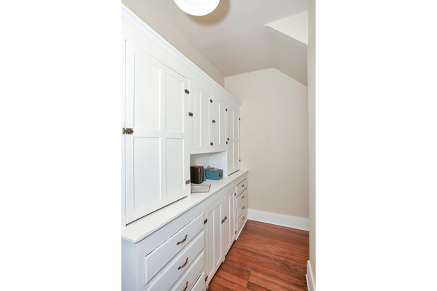 Situated between the dining room and kitchen is the home's original pantry, ensuring you'll never be short on cabinet space.