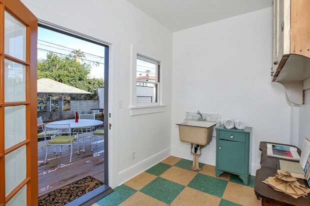 Rounding out the first floor is a laundry room tucked neatly away behind the kitchen, which also opens to the back yard, making for a simple task if you love the scent of sheets that are dried in a warm summer breeze.