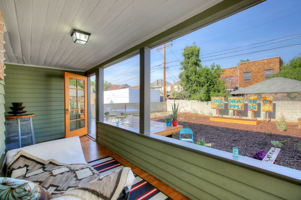 Outdoor living comes in many shapes and layers here, including this enclosed back porch, a huge wood deck and a concrete patio.