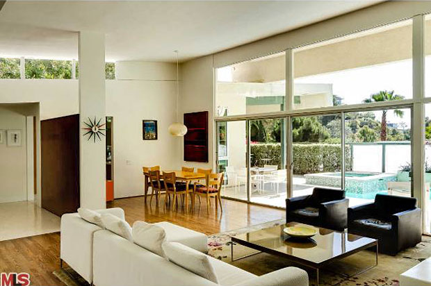he spacious and open living room feature oversized walls of glass with a southern exposure affording it loads of natural light.