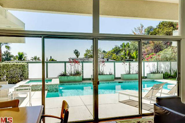 Need I say anything? Who wouldn't want this for a backyard? The saline and solar-heated swimming pool and spa make this home feel like a resort.