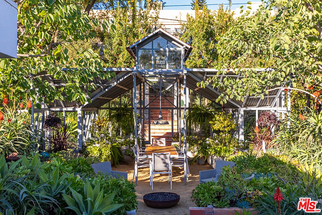 Designated as a Los Angeles Cultural Monument #866 in 2007, the property also features a restored 1908 glass greenhouse that has been re-purposed as an outdoor dining pavilion, surrounded by lush gardens.