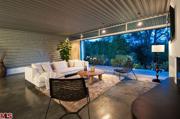 The use of corrugated materials in the design of a home can also be traced back to the Case Study program. In the original version of this home, corrugated plastic was installed between the rafters of the walkway between the carport and the entrance. Here, corrugated steel is used copiously and with a dramatic effect. What I love about it is that it has a feel that's simultaneously modern and vintage, residential and industrial.