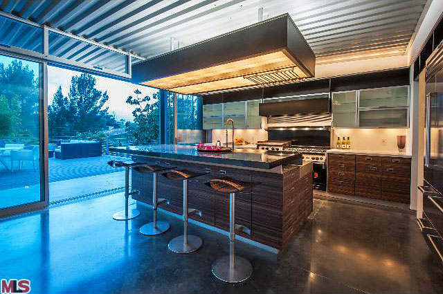 Bright, spacious, modern, airy, and functional are all apt descriptions of this beautifully designed kitchen. And, naturally, it features high-end appliances including a wolf stove and sub-zero fridge.