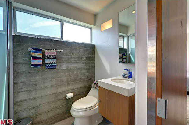 The second bathroom has its own cool little touches, such as the shower being placed outdoors. On the deck, just a few steps beyond, is a retro cedar hot tub.