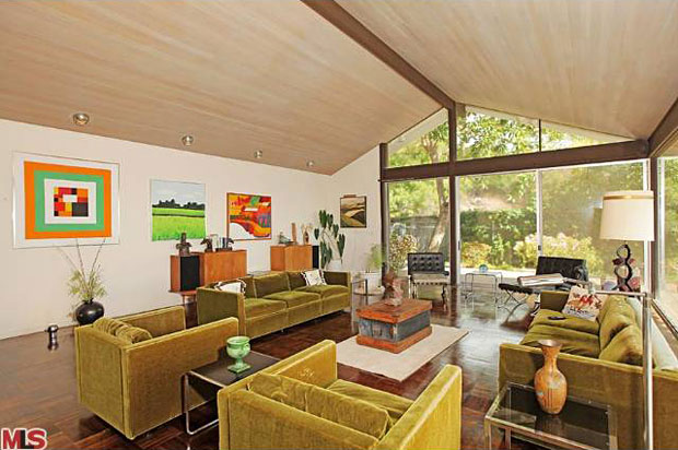 The living room opens up to a spacious lanai that overlooks the city...