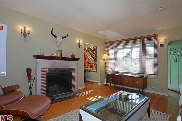 On the inside, the comforts include hardwood floors, a classic brick fireplace and plenty of natural light.