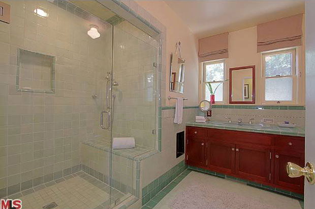 With a spacious sit-down shower, this bathroom does a beautiful job of balancing modern and vintage elements of design.