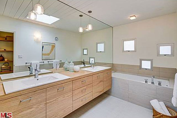 The home's remodeled bathrooms include a jet bath in the master, custom wood vanities with Caesarstone countertops and European tile.