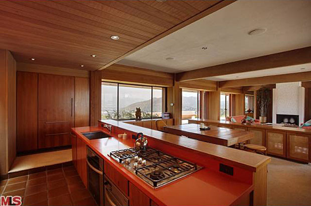 The entire house is clad is redwood inside and out and also features cabinets made of teak, and ceramic tile floors.