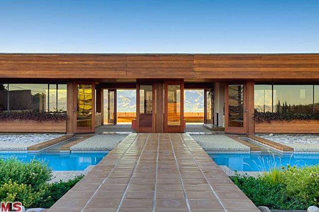 The roof of the garage doubles as a sundeck and it provides this amazing view of the house – clear through it, looking and then miles and miles of expanse beyond. You definitely feel like you are on top of the world here.