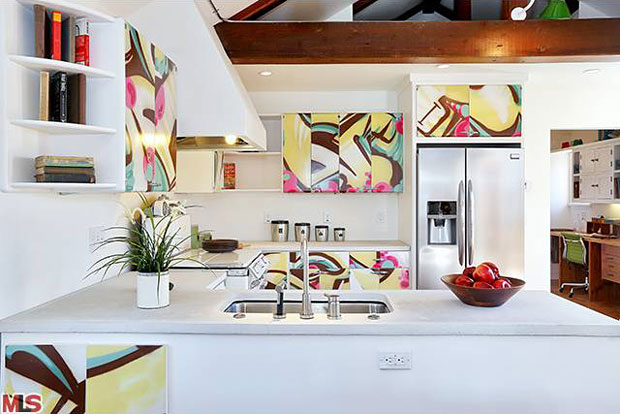 I guarantee you won't find kitchen cabinets that look like these at your local Home Depot. In fact, you won't find cabinets like these anywhere. These have been painted by established graffiti artist, Fuse.