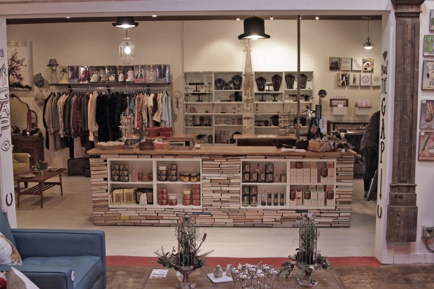 At the center of the store is rectangular sales counter, beautifully constructed from stacks of books, complete with built-in shelves. (If you're the type that has refused to throw all of your books since high school, here's a great way to put them to use!)