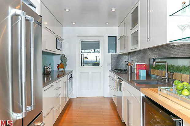The galley style kitchen has a very functional layout and has been beautifully remodeled in a euro-chic style that is stunning.