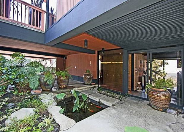 Even from the street this place is a looker. And it gets better every step of the way, starting with a koi pond traverse that leads to the front door, which is tucked away beneath the home's overhanging second level.